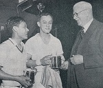 Eddy + david choong receive their silver tankards from sir george after the all england in 1951 resized
