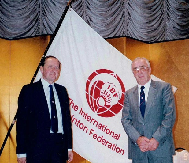 Ian palmer (r) with arthur jones pose in front of the ibf flag