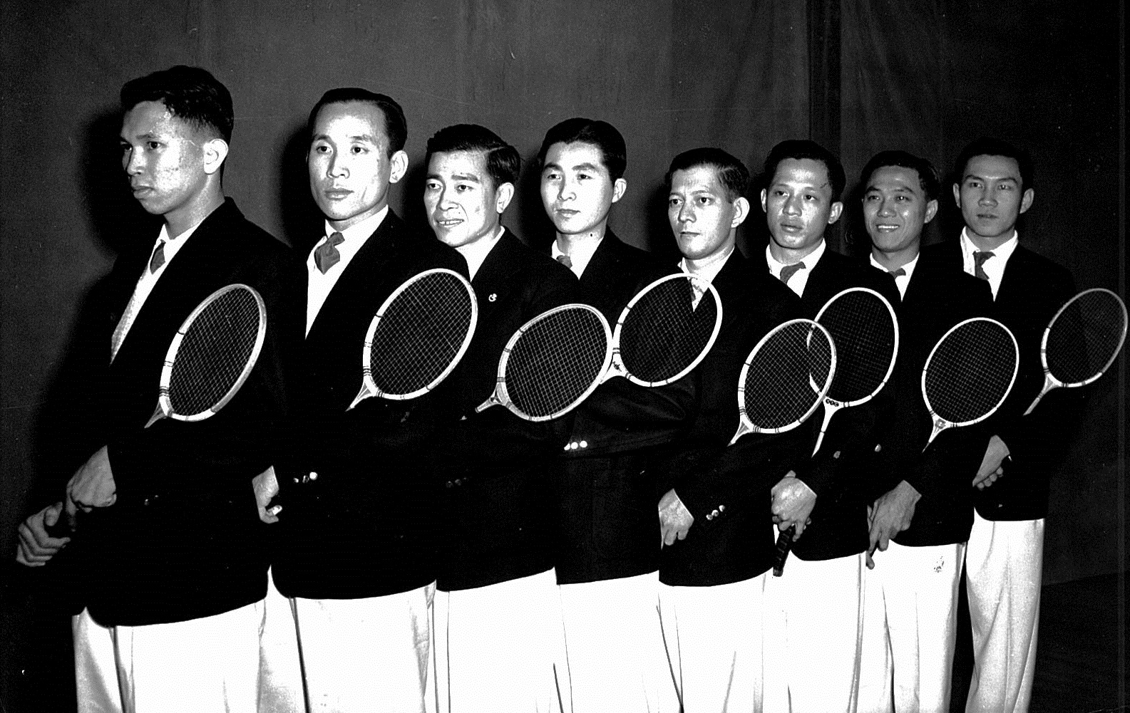 1948-49 thomas cup winners malaya pose with rackets -  ong poh lim 2nd from left - ap picture