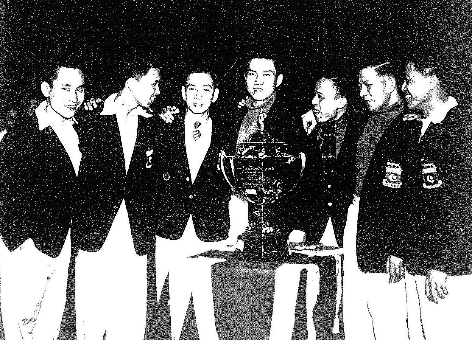 Thomas cup 1st winners malaya with trophy - preston, england feb 25-26, 1949 - malaya bt denmark 8-1. ong poh lim is at far left - ap picture