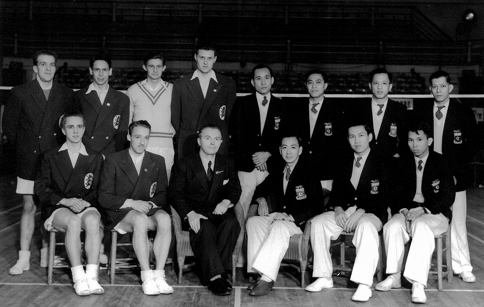 Thomas cup finalists denmark + malaya - preston, england - feb 25-26 1949 - ong poh lim is 5th from l standing - picture by arthur winter